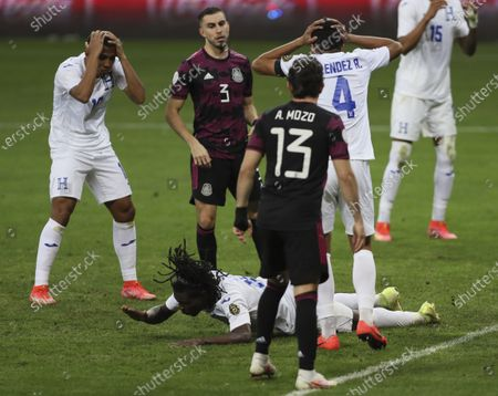 Honduras' Jose Garcia, bottom reacts after missing a chance to score against Mexico in extra time during the Concacaf Men's Olympic qualifying championship final soccer match in Guadalajara, Mexico