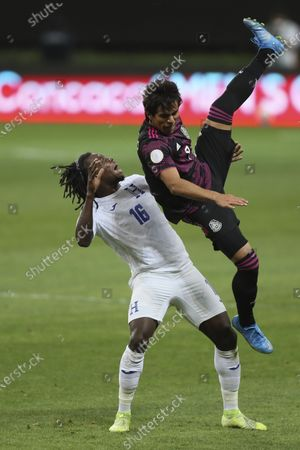 Honduras' Jose Garcia, left, and Mexico's Jose Macias fight for the ball during the Concacaf Men's Olympic qualifying championship final soccer match in Guadalajara, Mexico