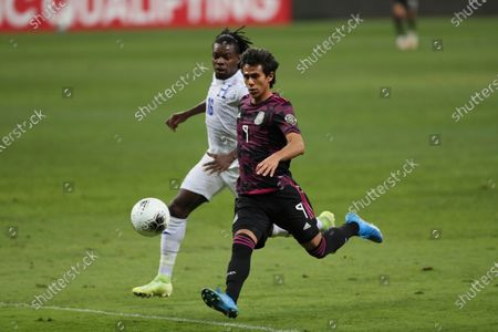 Mexico's Jose Macias, front, goes for the ball followed by Honduras' Jose Garcia during the Concacaf Men's Olympic qualifying championship final soccer match in Guadalajara, Mexico