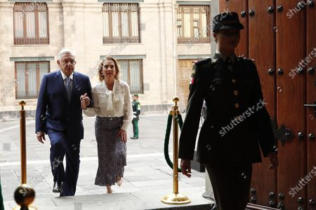 Mexican President Andres Manuel Lopez Obrador (L) and his wife Beatriz Gutierrez Mueller (2-L) arrive at an event to mark the 100th day of Lopez Obrador's third year of tenure, at the National Palace in Mexico City, Mexico, 30 March 2021.