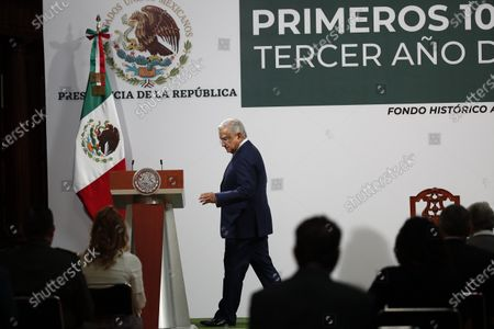 Mexican President Andres Manuel Lopez Obrador arrives to address the crowd on the 100th day of his third year of tenure, at the National Palace in Mexico City, Mexico, 30 March 2021.