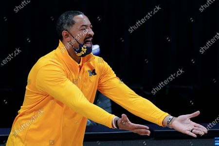 Michigan head coach Juwan Howard reacts to a call during the first half of an Elite 8 game against UCLA in the NCAA men's college basketball tournament at Lucas Oil Stadium, in Indianapolis