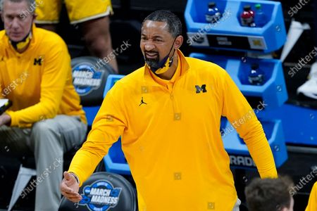 Stock Image of Michigan head coach Juwan Howard reacts to a call during the first half of an Elite 8 game against UCLA in the NCAA men's college basketball tournament at Lucas Oil Stadium, in Indianapolis