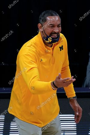 Stock Photo of Michigan head coach Juwan Howard reacts to a call during the first half of an Elite 8 game against UCLA in the NCAA men's college basketball tournament at Lucas Oil Stadium, in Indianapolis