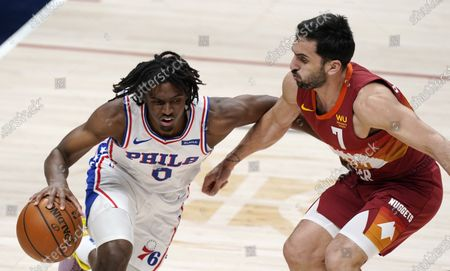 Stock Photo of Philadelphia 76ers guard Tyrese Maxey, left, drives up the court as Denver Nuggets guard Facundo Campazzo defends in the first half of an NBA basketball game, in Denver