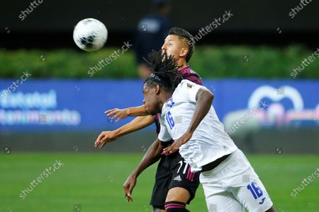 Jose Garcia (R) of Honduras in action against Roberto Alvarado (L) of Mexico, during the final match of the CONCACAF Men's Olympic Qualifying Soccer tournament between Mexico and Honduras, held at the Akron Stadium, in Guadalajara, Jalisco, Mexico, 30 March 2021.