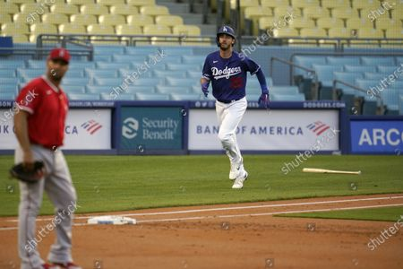 Los Angeles Dodgers' Cody Bellinger rounds the bases on a two-run home run during the first inning of a spring training exhibition baseball game against the Los Angeles Angels, in Los Angeles