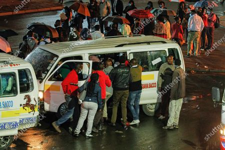 Commuters scramble to board public transportation minutes before the new 8pm-4am curfew takes effects.President Uhuru Kenyatta on Friday 26th March 2021 announced partial lockdown and instituted new curfew measures to start from 8pm to 4.00am. The new measures are to curb the spread of COVID-19 including placing Nairobi, Nakuru, Kiambu and Machakos counties under partial lockdown by closing bars and schools nationwide amid a third wave spread of COVID-19 across the country.