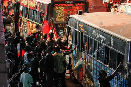 Commuters scramble to board public transportation home minutes before the new 8pm-4am curfew takes effect.On Friday, March 26th, President Uhuru Kenyatta announced a  partial lockdown and instituted new curfew measures to start from 8pm to 4am. The new measures to curb the spread of COVID-19 include placing Nairobi, Nakuru, Kiambu and Machakos counties under partial lockdown as well as closing restaurants, bars and schools nationwide amid a third wave of COVID-19 across the country.