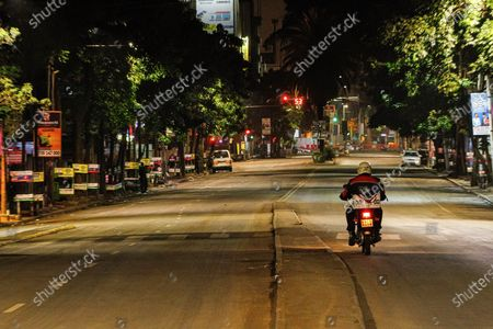 A motorcyclist riding along a deserted Moi Avenue in Nairobi as the new 8pm-4am curfew takes effects.On Friday, March 26th, President Uhuru Kenyatta announced a  partial lockdown and instituted new curfew measures to start from 8pm to 4am. The new measures to curb the spread of COVID-19 include placing Nairobi, Nakuru, Kiambu and Machakos counties under partial lockdown as well as closing restaurants, bars and schools nationwide amid a third wave of COVID-19 across the country.