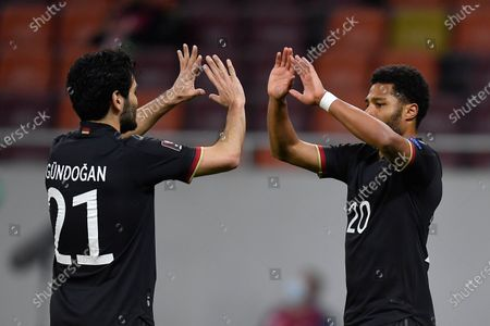 Serge Gnabry and Ilkay Gündogan celebrate during the game between Romania an Germany, in the World Cup 2022 Qualifiers, at National Arena Bucharest on March 28, 2021 in Bucharest, Romania.