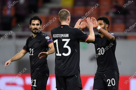 Lukas Klostermann, Serge Gnabry and Ilkay Gündogan celebrate during the game between Romania an Germany, in the World Cup 2022 Qualifiers, at National Arena Bucharest on March 28, 2021 in Bucharest, Romania.