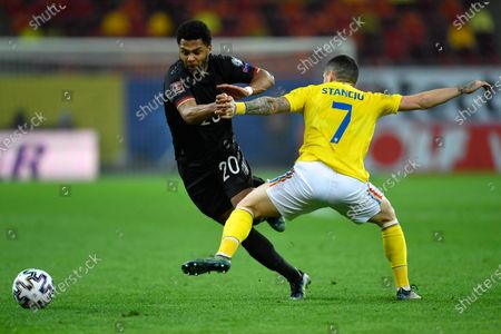 Serge Gnabry and Nicolae Stanciu during the game between Romania an Germany, in the World Cup 2022 Qualifiers, at National Arena Bucharest on March 28, 2021 in Bucharest, Romania.