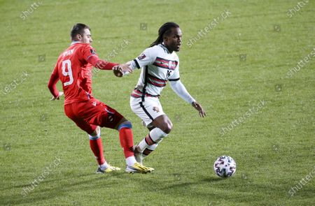 Renato Sanches of Portugal, Danel Sinani of Luxembourg (left)