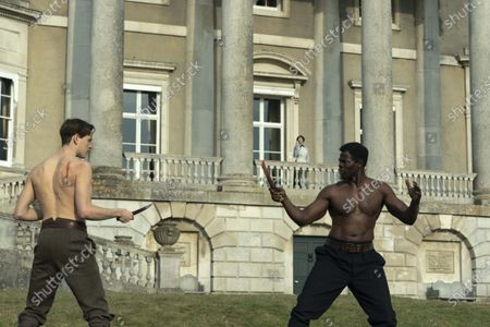 Harris Dickinson and Djimon Hounsou