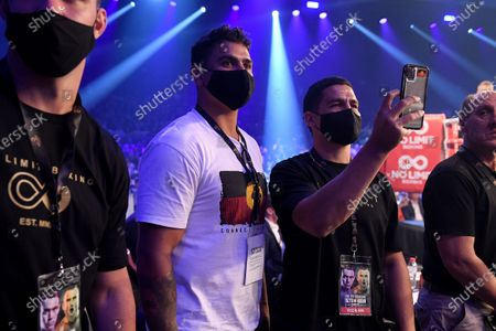 Stock Photo of Latrell Mitchell and Cody Walker watch on as Paul Fleming enters for his undercard bout during the Steel City Showdown ahead of the super welterweight bout between Australia's Tim Tszyu and Ireland's Dennis Hogan at the Newcastle Entertainment Centre, Newcastle, Australia, 31 March 2021.