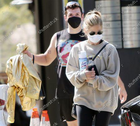 Sarah Michelle Gellar is seen talking to a friend