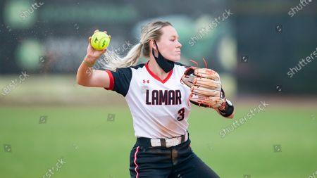 Lamar's Hannah Carpenter throws during warm ups between innings during an NCAA softball game against Stephen F. Austin, in Nacogdoches, Texas. Stephen F. Austin won 9-1