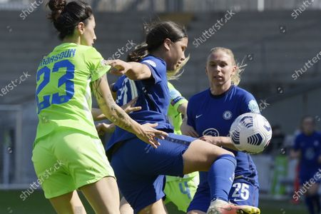 Stock Picture of Samantha Kerr (C) and Jonna Andersson (R) of Chelsea in action against Sara Doorsoun-Khajeh of Vfl Wolfsburg (L) during the UEFA Women's Champions League quarterfinal second leg soccer match Vfl Wolfsburg vs Chelsea in the Ferenc Szusza Stadium in Budapest, Hungary, 31 March 2021.