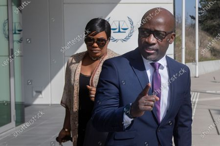 Former Ivory Coast youth minister Charles Ble Goude gestures as he arrives for a hearing at the International Criminal Court in The Hague, Netherlands, . Goude and former President Laurent Gbagbo were acquitted in 2019 of responsibility for crimes including murder, rape and persecution following disputed elections in 2010, with judges saying prosecutors failed to prove their case. International Criminal Court judges are ruling Wednesday on the appeal by prosecutors against the acquittal of Ivory Coast's former president and an ex-youth minister on charges of involvement in deadly violence that erupted after 2010 elections
