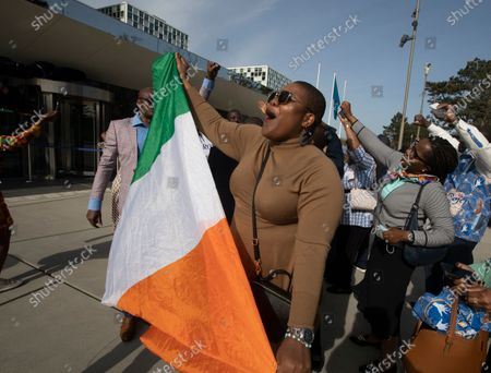 Supporters of Former Ivory Coast President Laurent Gbagbo and former youth minister Charles Ble Goude, celebrate their acquittal outside the International Criminal Court in The Hague, Netherlands, . ICC appeals judges on Wednesday upheld the acquittals Gbagbo and Ble Goude on charges of involvement in deadly post-election violence. Both were acquitted in 2019 of responsibility for crimes including murder, rape and persecution following disputed elections in 2010, with judges saying prosecutors failed to prove their case. The decision halted the trial before defense lawyers had even presented their evidence