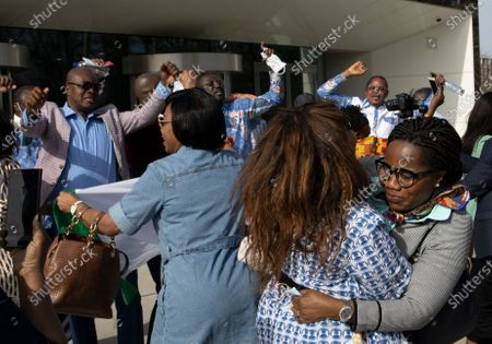 Stock Picture of Supporters of Former Ivory Coast President Laurent Gbagbo and former youth minister Charles Ble Goude, celebrate their acquittal outside the International Criminal Court in The Hague, Netherlands, . ICC appeals judges on Wednesday upheld the acquittals Gbagbo and Ble Goude on charges of involvement in deadly post-election violence. Both were acquitted in 2019 of responsibility for crimes including murder, rape and persecution following disputed elections in 2010, with judges saying prosecutors failed to prove their case. The decision halted the trial before defense lawyers had even presented their evidence