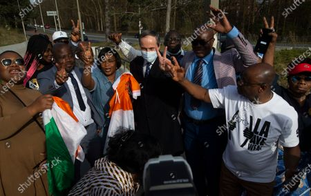 Stock Image of Lawyer Geert-Jan Knoops, center with face mask, celebrates with supporters of former Ivory Coast President Laurent Gbagbo and former youth minister Charles Ble Goude, after their acquittal at the International Criminal Court in The Hague, Netherlands, . ICC appeals judges on Wednesday upheld the acquittals of former president Gbagbo and Ble Goude on charges of involvement in deadly post-election violence. Both were acquitted in 2019 of responsibility for crimes including murder, rape and persecution following disputed elections in 2010, with judges saying prosecutors failed to prove their case. The decision halted the trial before defense lawyers had even presented their evidence