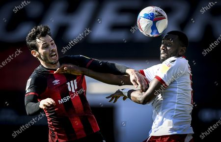 Adam Smith of AFC Bournemouth and Yannick Bolasie of Middlesbrough battle for the ball
