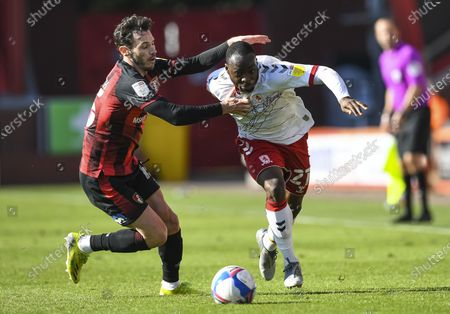 Neeskens Kebano of Middlesbrough is pulled back by Adam Smith of AFC Bournemouth