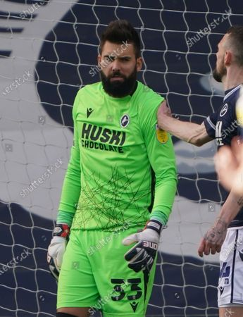 Stock Image of Millwall goalkeeper Bartosz Bialkowski after saving a penalty