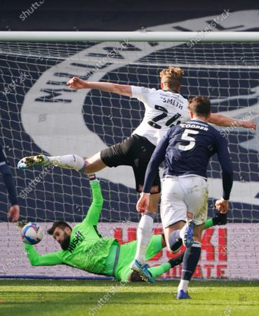 Stock Photo of Millwall goalkeeper Bartosz Bialkowski saves a late penalty from Michael Smith off Rotherham United