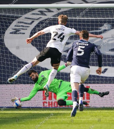 Millwall goalkeeper Bartosz Bialkowski saves a late penalty from Michael Smith off Rotherham United