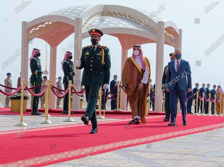 Stock Photo of In this photo released by the Saudi Royal Palace, Saudi Crown Prince Mohammed bin Salman, center right, accompanies Iraqi Prime Minister Mustafa al-Kadhimi on the red carpet on his arrival to Riyadh International Airport, in Saudi Arabia