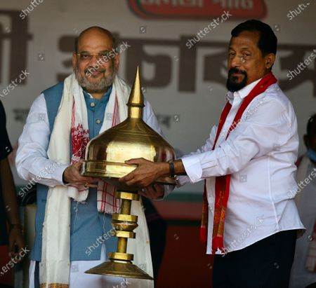 Indian Home Minister Amit Shah (L) is welcomed by Dispur constituency's Bharatiya Janata Party (BJP) candidate Atul Bora (R) during an election rally in Sonapur in Kamrup (metro) district of Assam, India, 31 Marth 2021. Assembly elections in the Indian state of Assam are scheduled to be held from 27 March to 06 April in three phases and results will be announced on 02 May 2021.