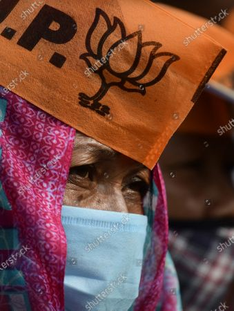 A Bharatiya Janata Party (BJP) supporter attends an election rally presided over by Indian Home Minister Amit Shah (not pictured), in Sonapur in Kamrup (metro) district of Assam, India, 31 Marth 2021. Assembly elections in the Indian state of Assam are scheduled to be held from 27 March to 06 April in three phases and results will be announced on 02 May 2021.