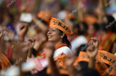 Bharatiya Janata Party (BJP) supporters attend an election rally presided over by Indian Home Minister Amit Shah (not pictured), in Sonapur in Kamrup (metro) district of Assam, India, 31 Marth 2021. Assembly elections in the Indian state of Assam are scheduled to be held from 27 March to 06 April in three phases and results will be announced on 02 May 2021.