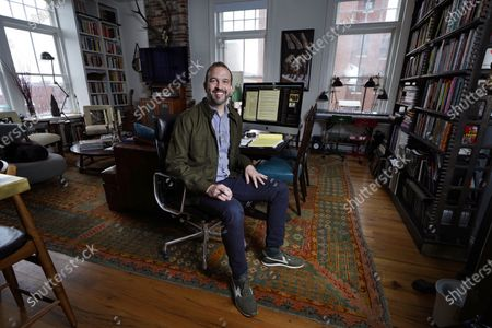 Matt Roberts, a writer on the SAG Awards, at his desk in his apartment, in Portland, Maine