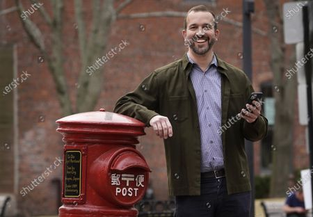 Stock Image of Matt Roberts, a writer on the SAG Awards, poses for a portrait at Post Office Park, in Portland, Maine