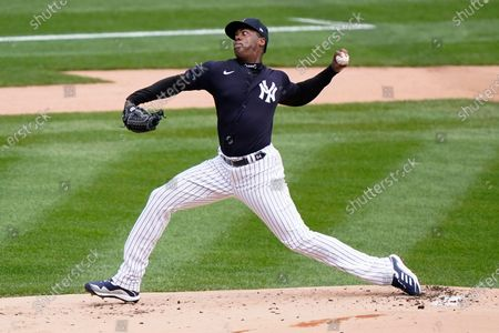 New York Yankees relief pitcher Aroldis Chapman throws live batting practice from the mound during a workout, at Yankee Stadium in New York. The Yankees face the Toronto Blue Jay on opening day Thursday