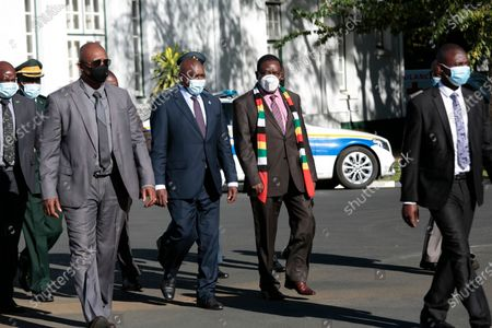 Botswana President Mokgweetsi Masisi (3-L) flanked by Zimbabwean President Emmerson Mngangagwa (2-R) arrive at the State House in Harare, Zimbabwe, 31 March 2021. Masisi is on a one day working visit to Zimbabwe.               .