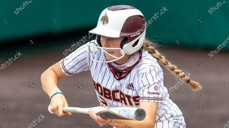 Texas State's Hannah Earls looks to bunt against Tarleton State during an NCAA softball game, in San Marcos, Texas