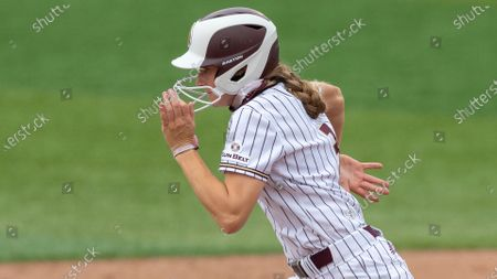 Texas State's Hannah Earls heads for second on a steal against Tarleton State during an NCAA softball game, in San Marcos, Texas