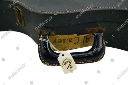 The guitar case with Al Casey's name label.   The guitar that helped launch Elvis Presley's famous comeback has sold for £450,000.  The 'King' fell in love with the lipstick red Hagstrom Viking II electric guitar that belonged to his session musician, Al Casey, at the time.   Elvis borrowed it for a TV concert that was broadcast in December 1968, marking the star's comeback after seven years of making movies.