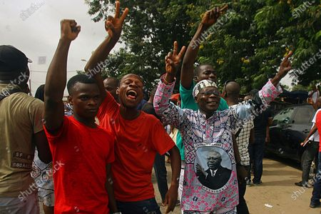 Supporters of former Ivory Coast President Laurent Gbagbo celebrate in Abidjan, after the International Criminal Court appeals judges in The Hague upheld the acquittals of Gbagbo and former minister Charles Ble Goude on charges of involvement in deadly post-election violence. Both were acquitted in 2019 of responsibility for crimes including murder, rape and persecution following disputed elections in 2010, with judges saying prosecutors failed to prove their case