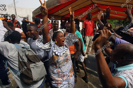 Stock Photo of Supporters of former Ivory Coast President Laurent Gbagbo celebrate in Abidjan, after the International Criminal Court appeals judges in The Hague upheld the acquittals of Gbagbo and former minister Charles Ble Goude on charges of involvement in deadly post-election violence. Both were acquitted in 2019 of responsibility for crimes including murder, rape and persecution following disputed elections in 2010, with judges saying prosecutors failed to prove their case