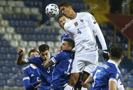 Raphael Varane (C-R) of France in action during the FIFA World Cup 2022 qualifying soccer match between Bosnia & Herzegovina and France in Sarajevo, Bosnia and Herzegovina, 31 March 2021.