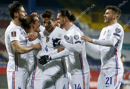 Antoine Griezmann (2-L) of France celebrates with teammate Olivier Giroud(L) and Raphael Varane (3-L) after scoring the opening goal during the FIFA World Cup 2022 qualifying soccer match between Bosnia & Herzegovina and France in Sarajevo, Bosnia and Herzegovina, 31 March 2021.