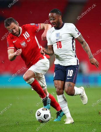 Grzegorz Krychowiak of Poland (L) and England's Raheem Sterling (R) in action during the FIFA World Cup 2022 qualifying soccer match between England and Poland in London, Britain, 31 March 2021.