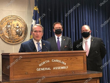 Stock Photo of Paul Newton, R-Cabarrus, left, speaks while Sens. Chuck Edwards, R-Henderson, center, and Ralph Hise, R-Mitchell, stand at a news conference at the Legislative Building in Raleigh, N.C. on . Newton is a primary sponsor of an elections measure heard in a Senate committee later Wednesday that in part would adjust deadlines to request absentee ballots and to turn them in to county election offices