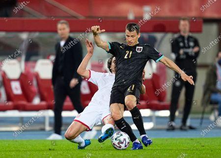 Thomas Delaney of Denmark and Stefan Lainer of Austria during Austria and Denmark on Ernst-Happel-Stadion stadium, Vienna, Austria